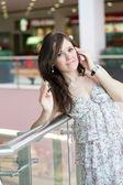 Beautiful girl speaks by phone — Stock Photo