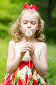Portrait of the beautiful little girl with a dandelion — Stock Photo