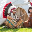 North AmericIndians sit at wigwam — Stock Photo #6305751