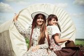 Beautiful girls in style of the country — Stock Photo