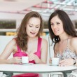 Two girls sitting in cafe — Stock Photo