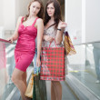 Two friends with purchases — Stock Photo #6389215