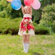Happy girl with balloons — Stock Photo #6389247