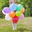 Happy girl with balloons — Stock Photo #6389250