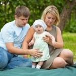 Family having picnic in park — Stock Photo