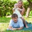 Family having picnic in park — Stock Photo #6559244