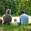 Family having picnic in park — Stock Photo #6559254