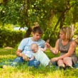 Family having picnic in park — Stock Photo #6559255