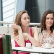 Two girls sitting in cafe — Stock Photo #6638704