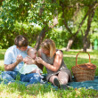 Stock Photo: Family having picnic in park