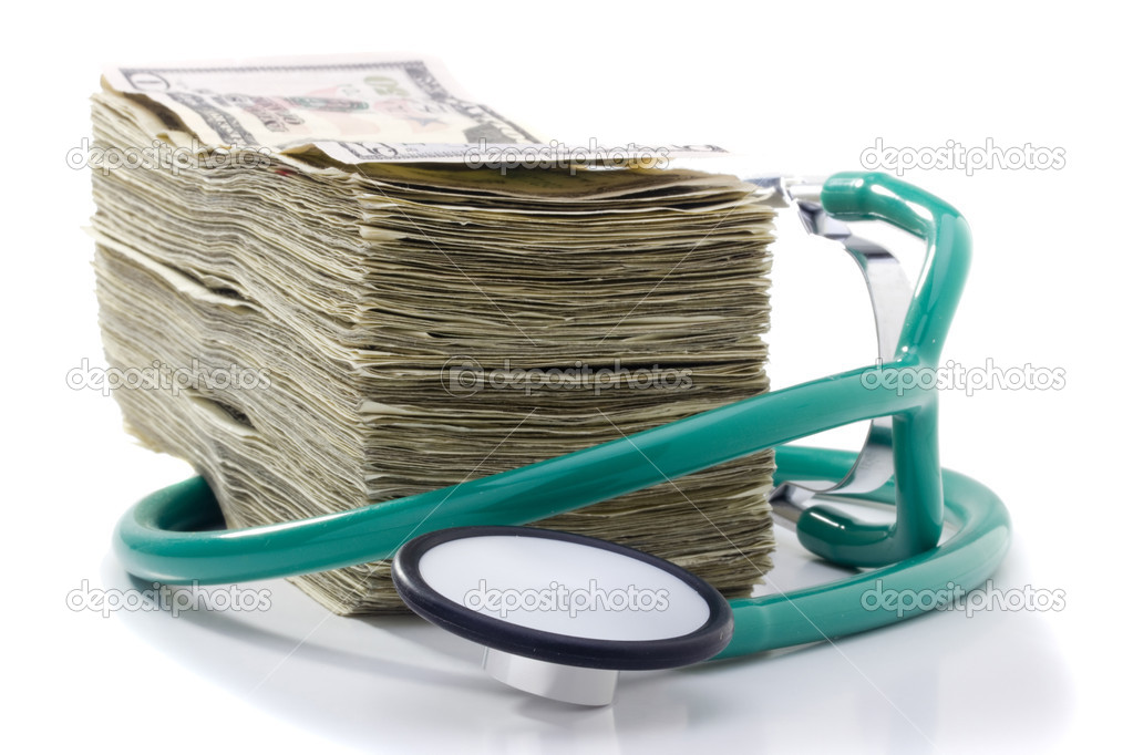 Stack of money and a stethoscope on a white background.  Foto de Stock   #5603159