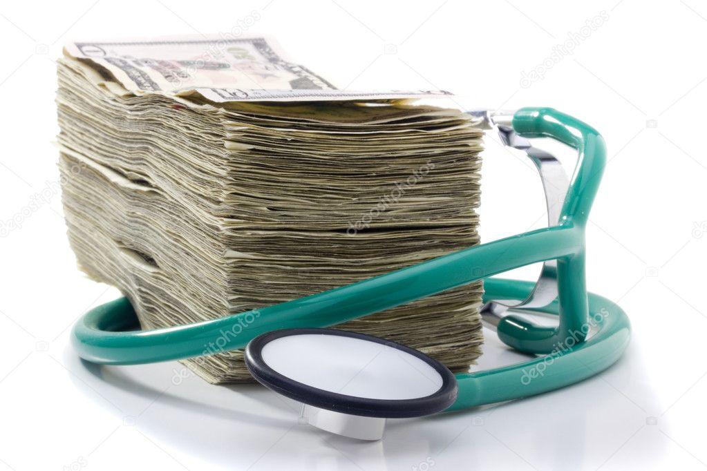 Stack of money and a stethoscope on a white background. — Zdjęcie stockowe #5603159