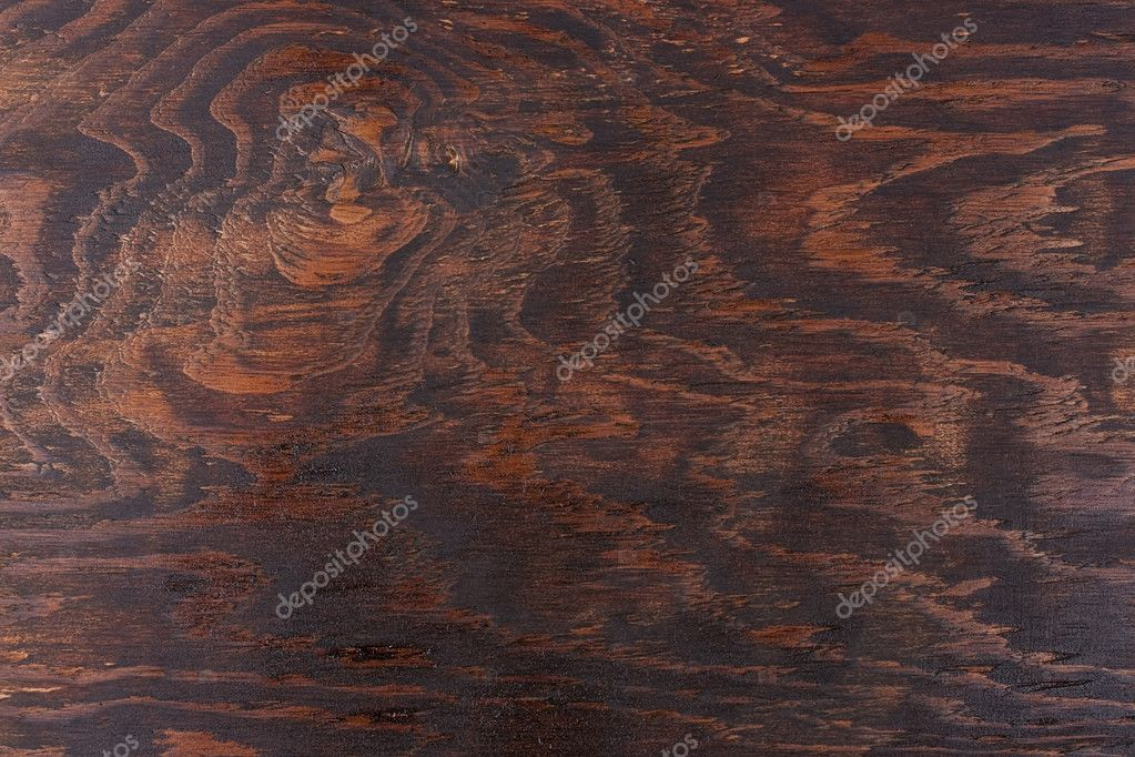 Dark background made of a wood and processed by a special chemical compound. — Stock Photo #6009504