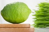 Lime and Wheatgrass — Stock Photo