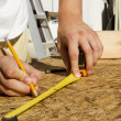Worker Measuring Plywood - Stockfoto