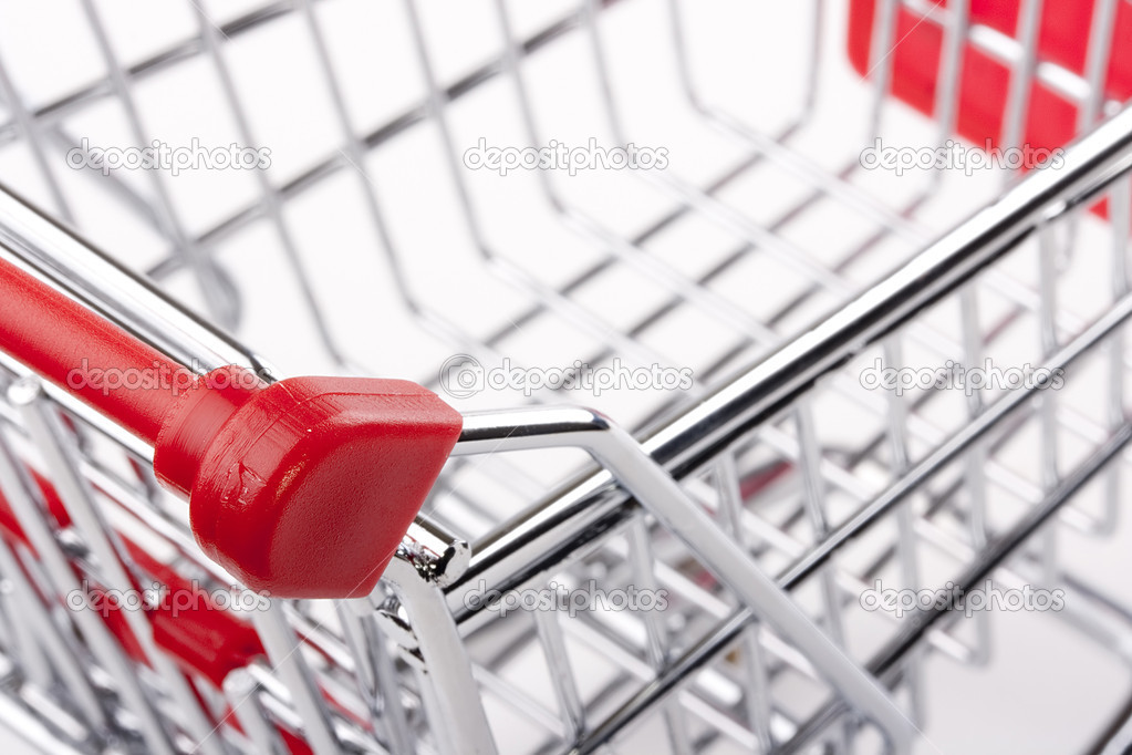 Empty shopping cart with the red handle on a white background. — Stock Photo #6694162