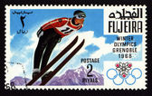 Postage stamp from Fujeira, Winter Olympic Games in Grenoble 1968 — Stock Photo