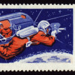 Stock Photo: Postage stamp with soviet Cosmonaut Aleksei Leonov in space