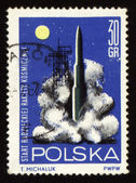 Start der rakete auf briefmarke der post — Stockfoto
