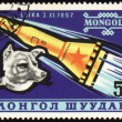 Soviet rocket and dog Laika on Mongolian post stamp — Стоковая фотография