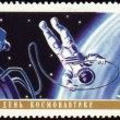 Stock Photo: Postage stamp with Cosmonaut in open space