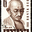 Mohandas Karamchand Gandhi portrait on postage stamp - Stock Photo