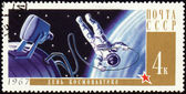 Postage stamp with Cosmonaut in open space — Stock Photo