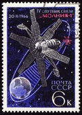 Postage stamp with communication satellite in space — Stock Photo