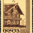 Old wooden house on post stamp — Stock Photo