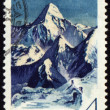 Khan Tengri peak in Central Tien Shan on post stamp — Stock Photo