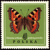 Butterfly Vanessa on post stamp — Stock Photo