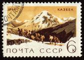 郵便切手山カズベク上の表示します。 — ストック写真