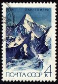 Khan Tengri peak in Central Tien Shan on post stamp — Stock Photo