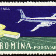 Airport of Bucharest and large plane on post stamp — Stock Photo