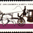 Royalty-Free Stock Photo: Coupe - old carriage on post stamp