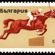 Royalty-Free Stock Photo: Horse race on post stamp