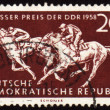 Royalty-Free Stock Photo: Horse riding sports on post stamp