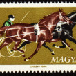 Stock Photo: Competition in chariot race on post stamp