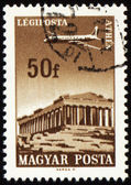Flying plane above the Athens on post stamp — Stock Photo