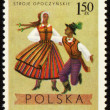 Polish folk dancers from Opoczynski region on post stamp - Stock Photo