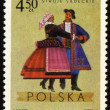 Polish folk dancers from Sadecki region on post stamp - Stock Photo