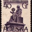 Polish astronomer Mikolas Kopernik on post stamp - Stock Photo