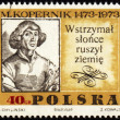 Stock Photo: Nicolaus Copernicus, great polish astronomer on post stamp
