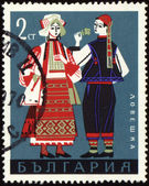 Bulgarian national costumes from Lovech on post stamp — Stock Photo