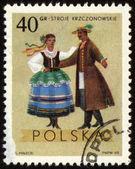 Polish folk dancers from Krzczonowskie region on post stamp — Stock Photo