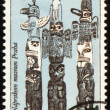 Royalty-Free Stock Photo: American indian totem poles on post stamp
