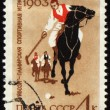 Guybozi - horse folk game in Pamir on post stamp — Stock Photo