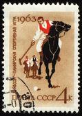 Guybozi - horse folk game in Pamir on post stamp — Stock Photo