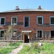Old abandoned two-storeyed wooden house - Stock Photo
