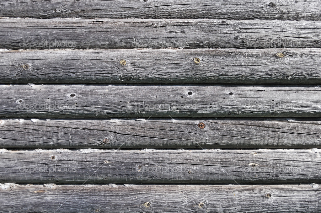 Fragment of old log wall background of abandoned wooden house — Stock Photo #5694369